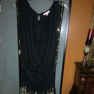 Black dress with glitter accent on bottom and side